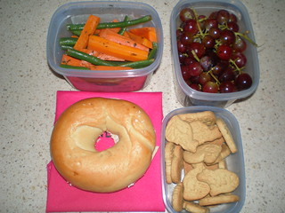 Bages with cream cheese; Green Beans and Carrots in a Tarragon Vinaigrette; red grapes; animal crackers