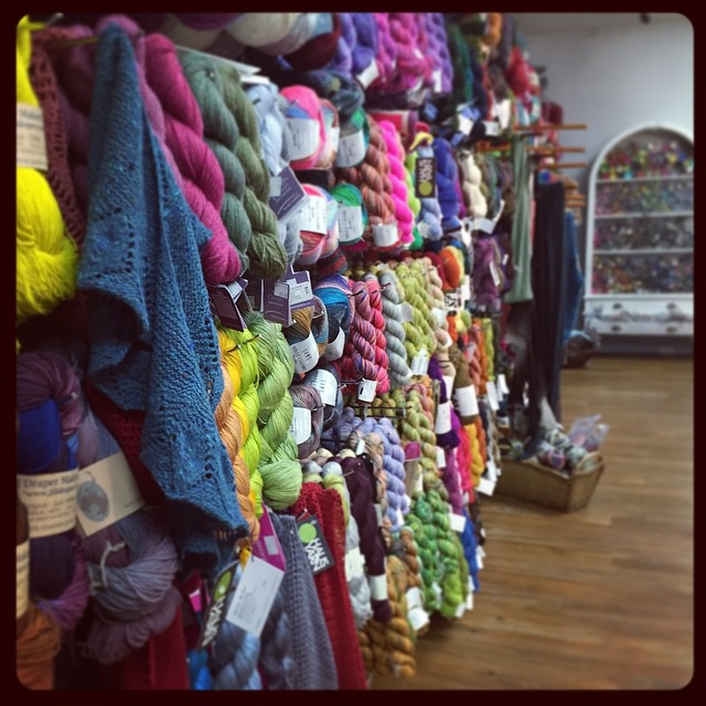 More from Yarn Haus - wall of yarn, next to a wall of buttons. #lys #yarn