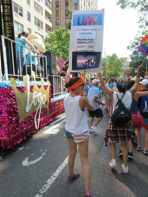 Rebecca Weinlauf marching with the RuPaul's All Stars Drag Race (season 2) Logo TV float with actor Nico Tortorella in NYC Pride, The March, New York City, USA 2016