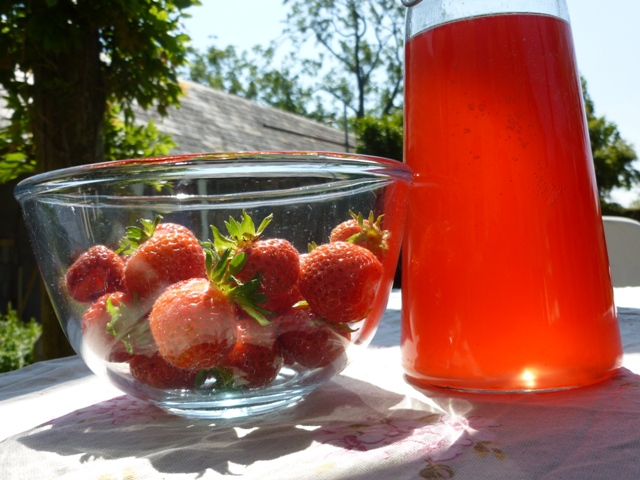 Pink Elderflower Cordial and strawberries from the garden