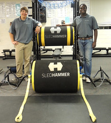 Inventors Vaughn Maceina, left, and Sesie Bonsi, right, worked with Auburn mechanical engineering students to create the SledHammer strength-training device.