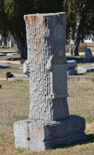 Woodmen of the World grave marker with scroll