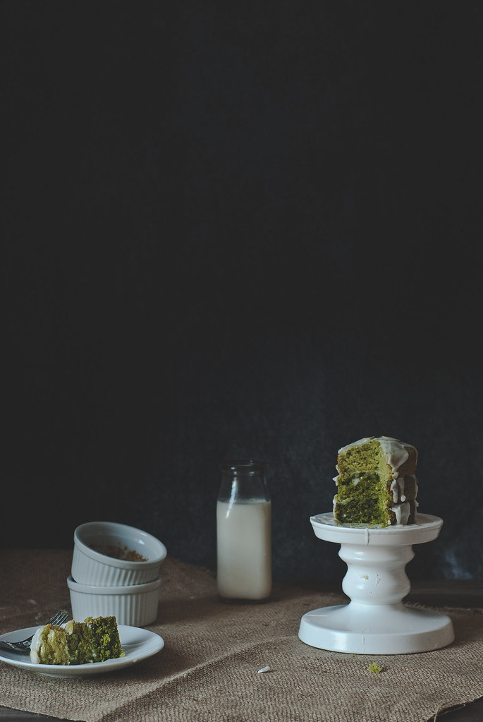 Miniature matcha layer cake with coconut glaze.