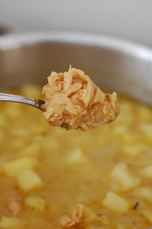 Adding the garlic to the Creamy Roasted Garlic & Potato Soup by Eve Fox, the Garden of Eating, copyright 2015