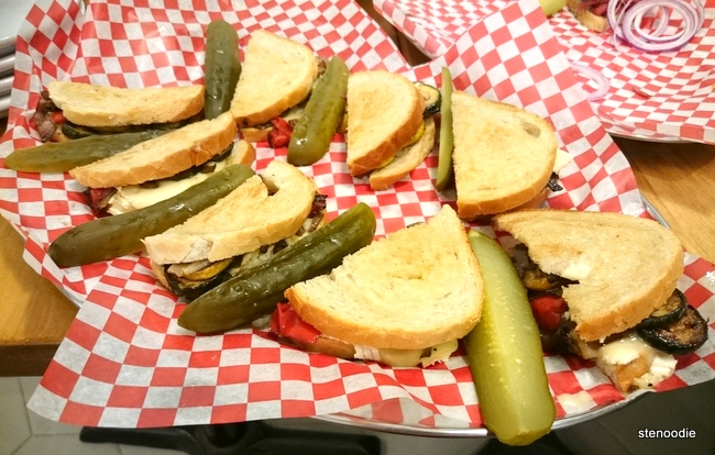 Platter of Veggie Reuben sandwiches with pickles