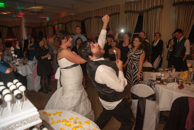 The bride and groom rocking out with their cake pops!