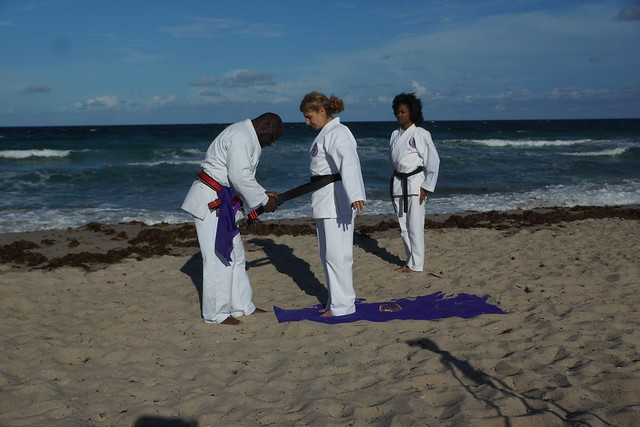 Senpai receiving 3rd degree black belt in ceremony