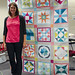 Katie in front of a quilt from her Book! by JessieAller