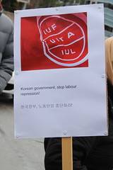 PSI staff members joined by other Global Union staff members in Geneva demonstrate in front of the Korean mission - 17 January 2014.  Faced with extreme repression, including a violent raid on the Korean Confederation of Trade Unions headquarters by government forces, the Korean labour movement will hold two national strikes on 9 and 18 January 2014 to demand the withdrawal of criminal charges, the damage suit, the dismissals and disciplinary measures against the rail workers' union, an end to labour repression in Korea, and an end to the unilateral pursuit of privatisation.  More information: www.world-psi.org/en/support-korean-workers-hold-protests...