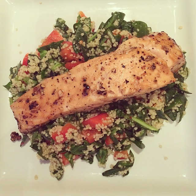 Pan fried in lemon juice and pepper, salmon fillet and warm salad.