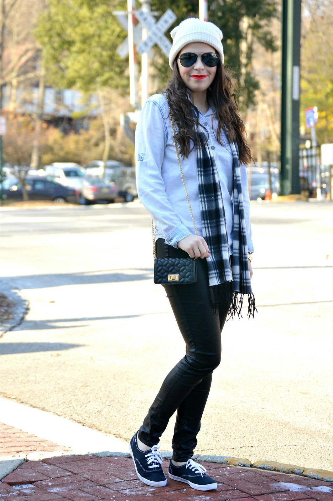 leather pants and plaid scarf with beanie