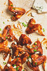 Chipotle Maple Chicken wings with chives and blue cheese.