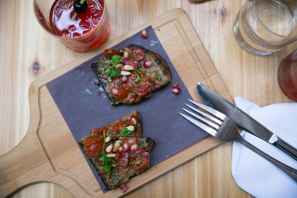 Eggplant Byladi with pomegranate and pine nuts