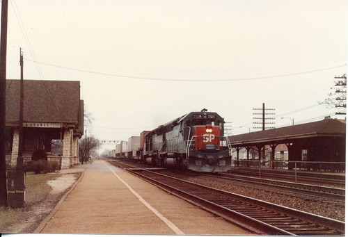 Eastbound Southern Pacific freight train passing the Stone Avenue station.  La Grange Illinois.  February 1986. by Eddie from Chicago