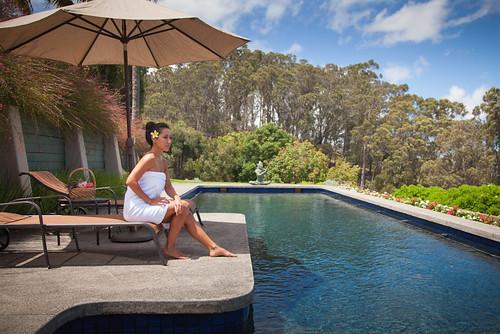 Maui Spa Retreat_Woman by Pool, Photo Courtesy of Maui Spa Retreat