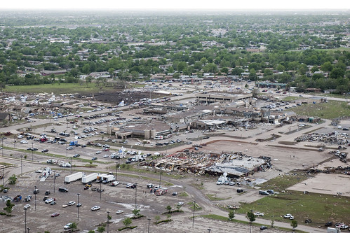 <p>An aerial view of tornado damage in Moore, Okla., May 21, 2013. The Oklahoma National Guard assisted with disaster response efforts after an EF5 tornado with winds exceeding 200 miles per hour tore through the Oklahoma City suburb May 20, 2013, killing at least 24 people, injuring more than 230 and displacing thousands. (DoD photo by Maj. Geoff Legler, U.S. Army National Guard/Released)</p>