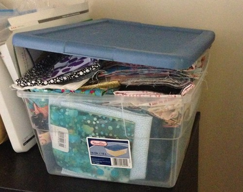 Overflowing box of fabric for 100 quilts for kids by zaydia {modernbias.com}