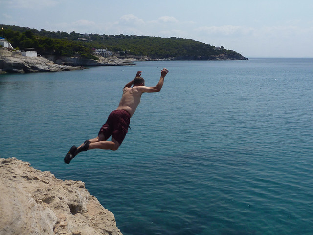 Chris jumping off a cliff on Aegina