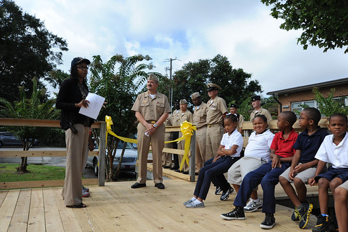 Lisa Rex, principal of Central Elementary School, introduces Capt. Robert A. Hall, Jr., commanding officer of (PCU) America (LHA