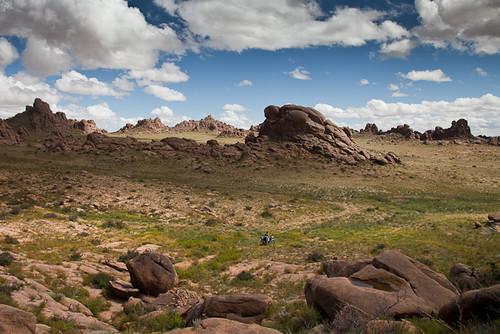 clouds landscape rocks desert motorbike mongolia valley gobi province mongolian herder dundgovi