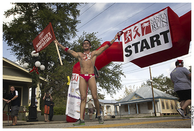 race winner Malcolm Williams crosses the finish line for the 2013 Santa Speedo run Tampa Bay