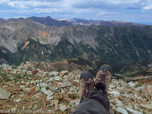 I may not have the camping equipment for backpacking…but I do like my hiking boots! (Enjoying the view in Electric Pass.)