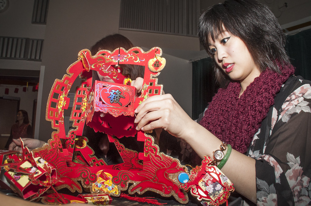 Terilyn Ma puts together decorations in preparation for the Chinese program's New Year celebration in Jack Adams Hall Friday, Feb. 21. Photo by Jessica Christian / Xpress