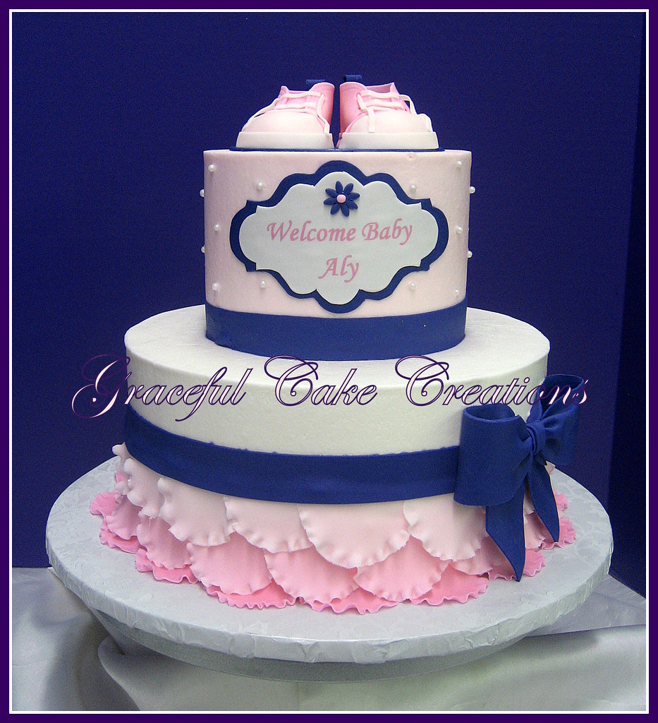 elegant pink and purple baby shower cake with pink tennis shoes a