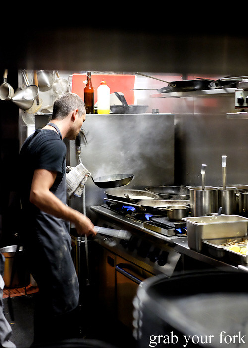 Chef cooking in the kitchen at Berta Surry Hills