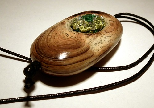 paper pendant on black silk cord