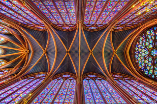 Stain glass and roof on second floor of la Sainte-Chapelle in Paris.