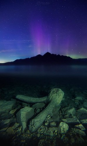 """Between Worlds"" Result of some experimenting with the underwater housing a couple of nights ago at Lake Minnewanka. Above, aurora pillars explode from behind Mount Astley. Below, evidence of the many trees that were flooded when the lake level was raised"