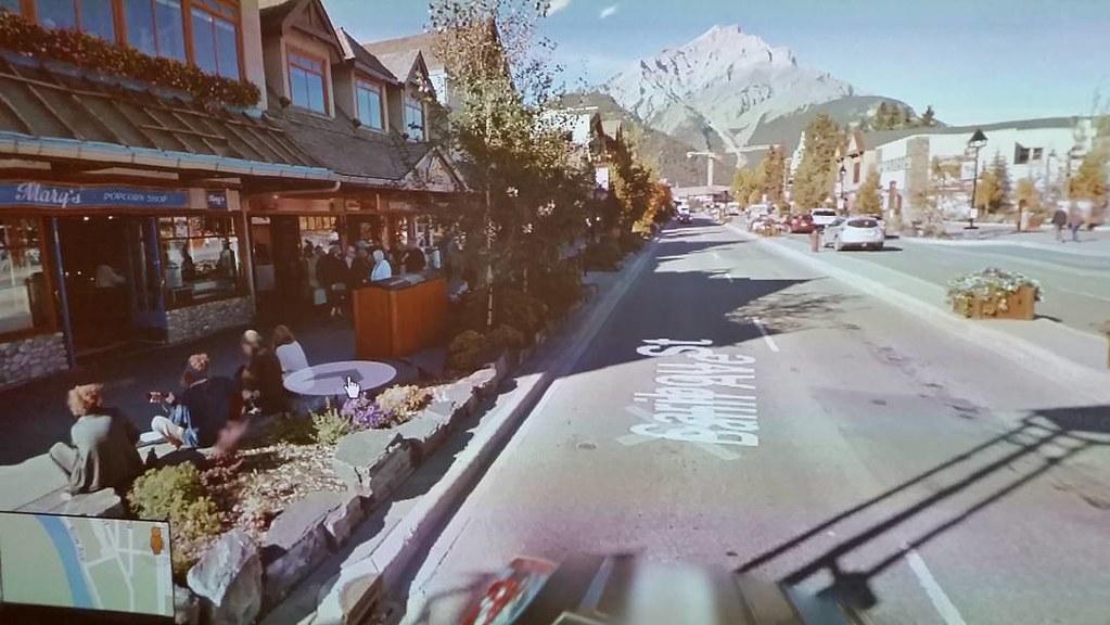 Banff avenue with hippie kids and a crane Sept 2015 #ridingthroughwalls