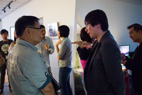 Edward Chia of Timbre giving advice to a participant of UCP.
