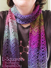 Scarf being modeled around a neck