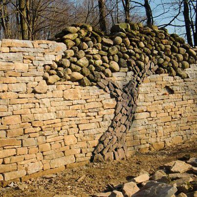 3 add a stone design within your rock wall - Rock Wall Design