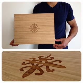 Custom caramel bamboo portfolio book with engraving treatment
