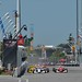 The green flag flies over the field for the start of the Honda Indy Toronto
