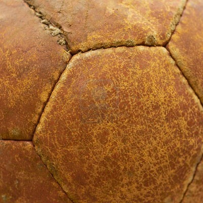 7575983-leather-texture-of-an-old-football-ball-closeup-shot