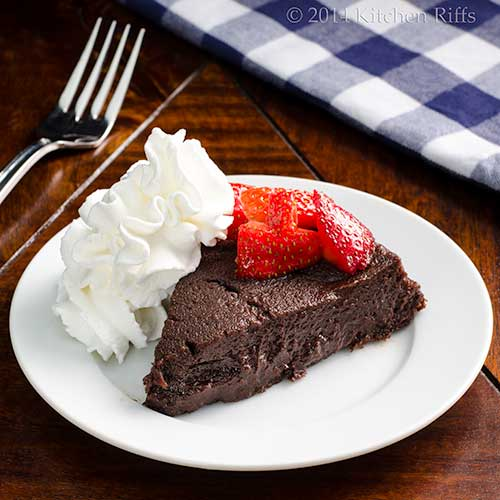 Boca Negra Cake with whipped cream and strawberry garnish