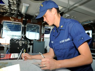 Petty Officer 2nd Class Hali Lombardi, plots a position on the chart during a training exercise on the Coast Guard Cutter Charles Sexton in Key West, Fla., Jan. 28, 2014. Lombardi, a Key West native, is one of 21 crew members that will become a plank owner when the cutter Sexton becomes commissioned March 8, 2014. (U.S. Coast Guard photo by Petty Officer 2nd Class Sabrina Laberdesque(