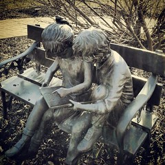Cute children reading sculpture in Woodburu, NJ park...cache #2