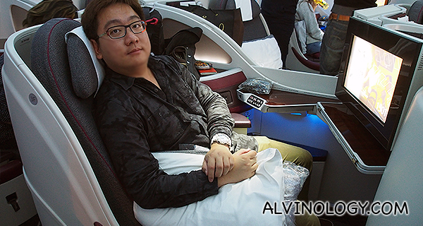 Me enjoying the Business Class flight experience with the Qatar Airways 747 Dreamliner