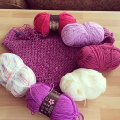 Can I ask for some help please from the expert ladies who put colours together so well. Am making a shawl for my mum. Main part is in the centre. The border is done in 4 different colours. Am trying to use some of my stash so can I ask opinions on what co