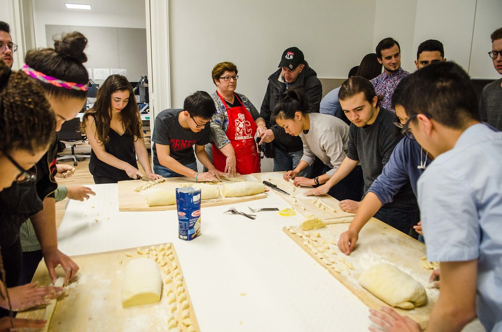Flati teaches students how to make gnocchi from scratch in the kitchen at the palazzo.
