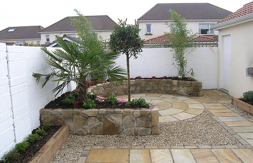create a cozy outdoor space with a curved rock wall garden stones