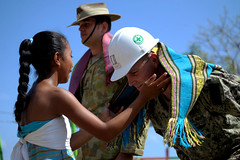 U.S. Navy Seabee Navy Lt. Brent Oglesby, the officer-in-charge of Naval Mobile Construction Battalion (NMCB) 3's Construction Civic Action Detail in Timor-Leste, receives a tais, or scarf, from a Timorese girl during an official ribbon cutting ceremony and close of the 28-day Sapper 13 exercise. (U.S. Navy photos by Mass Communication Specialist 1st Class Chris Fahey)