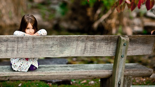 Child Sitting On Bench Wallpaper