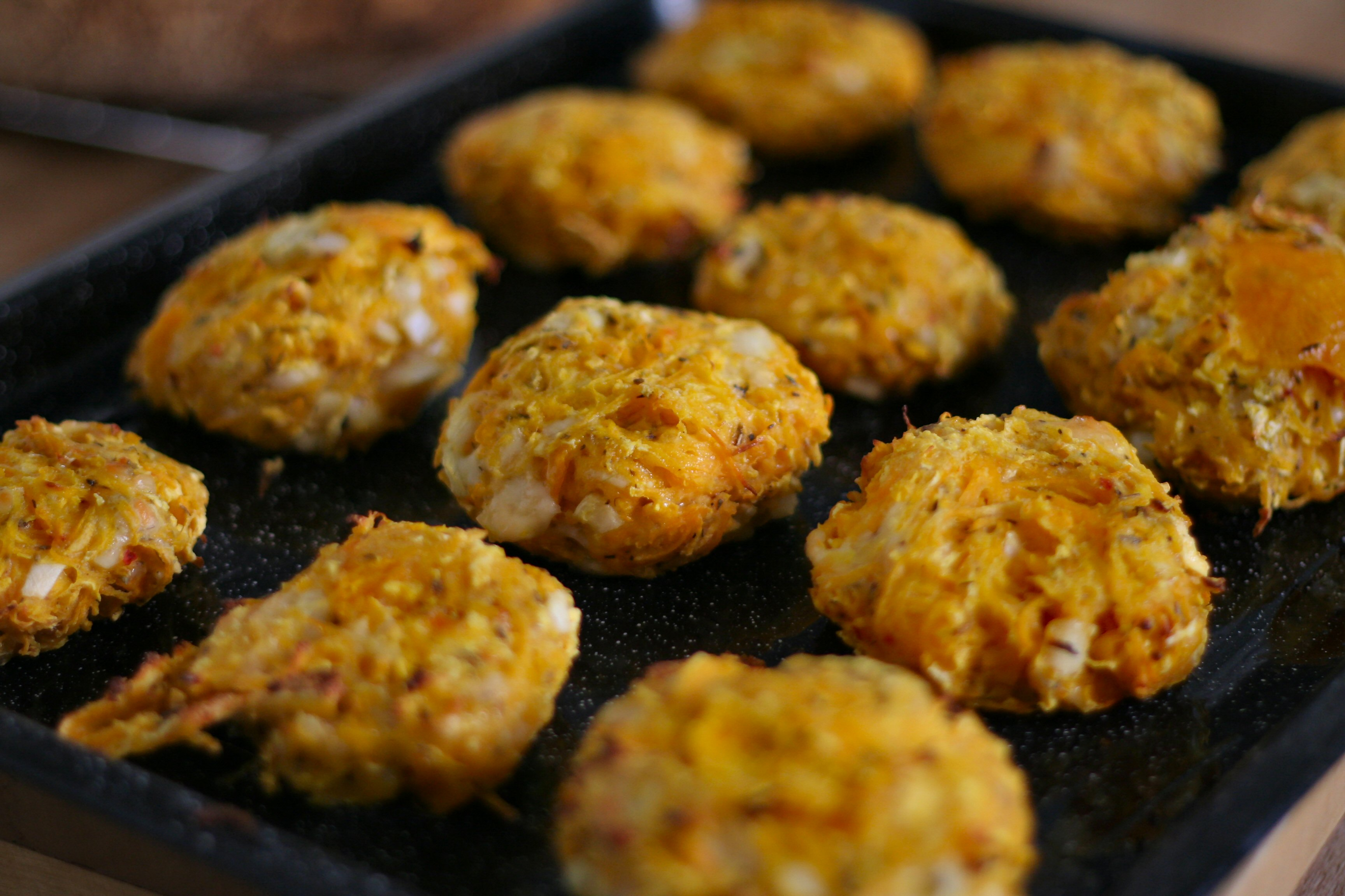 Squash & manchego patties on baking tray