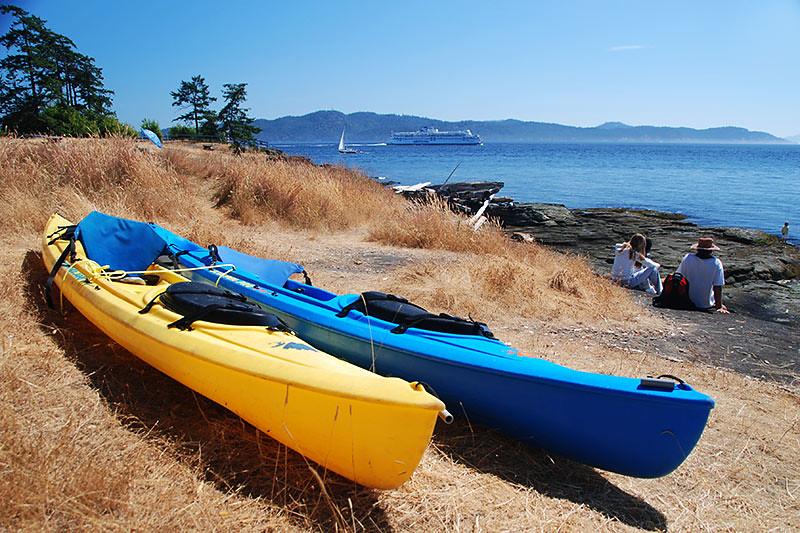 Kayaks parked at Ruckle Park, Saltspring Island, Gulf Islands National Park, British Columbia, Canada